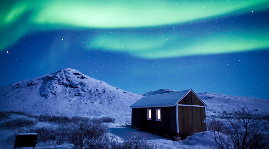 Northern Lights On A Clear Night Near A Backcountry Hut In Kangerlussuaq In Greenland